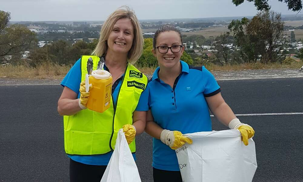 Lisa Reppin (left) and Danielle Johnston clean up around the Blue Lake.