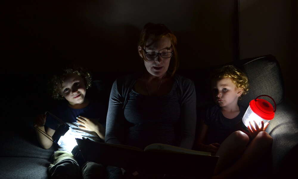 Matthew, Emily and Tommy Izzard read by torchlight during Earth Hour.