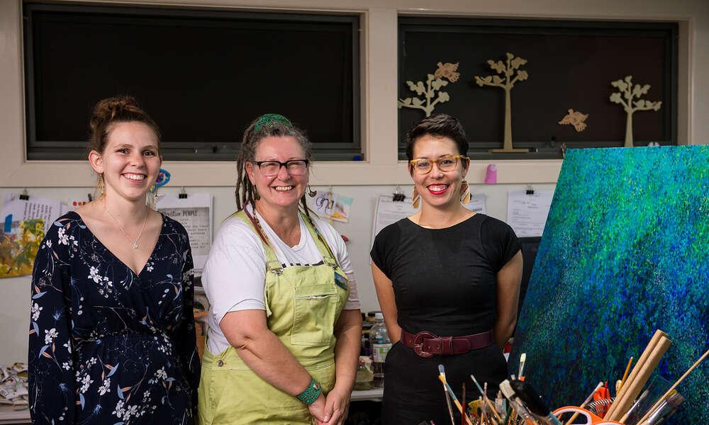 Brittany Van Zeil (left), Gina Raisin and Serena Wong discuss the upcoming exhibition 'Murmuration' at Gina's Studio