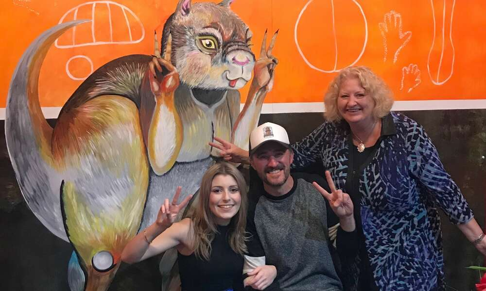 Artist Mel Cecotti (left), Ben Deering and City of Mount Gambier Manager Tourism and Economic Development Donna Foster are 'photobombed' by 'Simo'.