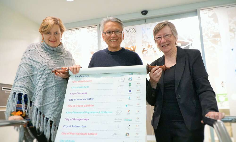 Mayor Andrew Lee is pictured holding the Welcome Scroll with Mount Gambier Migrant Resource Centre Manager Anelia Blackie (left) and Rural Australians for Refugees & Refugee Council of Australia's Jan Govett.