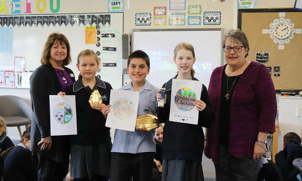 City of Mount Gambier Community Events Team Leader Denise Richardson with logo competition winners Chloe, Archie and Maddison from Tenison Woods College and Mount Gambier History Group Vice President Lynn Lowe.