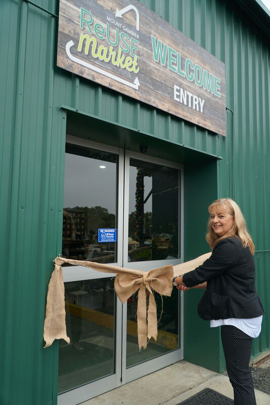 Deputy Mayor Sonya Mezinec cuts the ribbon to officially open the Mount Gambier ReUse Market.