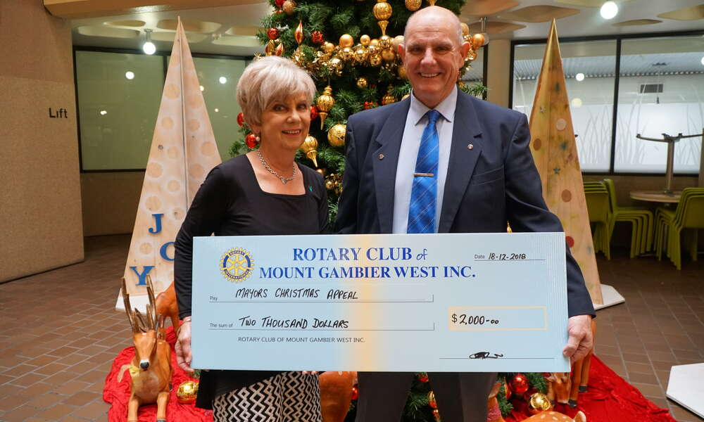 Rotary Club of Mount Gambier West President Greg Appleyard presents a donation of $2000 to Mayor Lynette Martin for the Mount Gambier Community Mayor's Christmas Appeal.