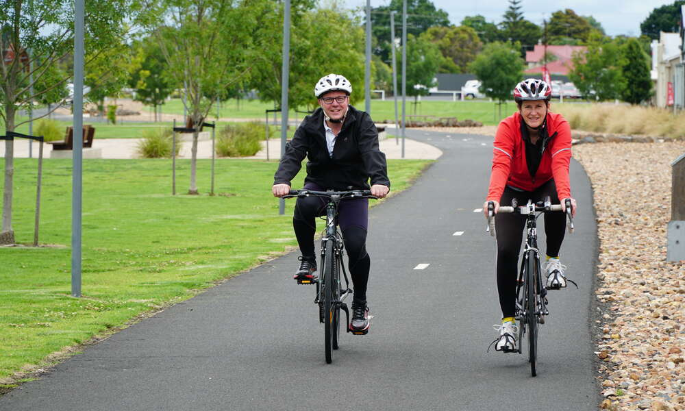 Paul Gibbs and Tracy Tzioutziouklaris on a leisurely ride along the Rail Trail.