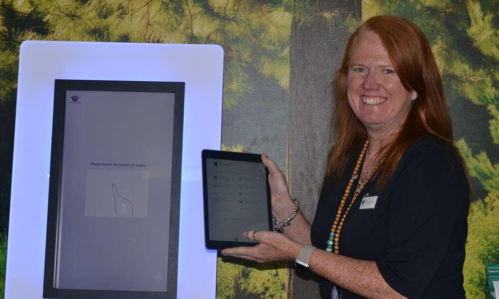 Library Manager Georgina Davison with the new Libraries SA app.