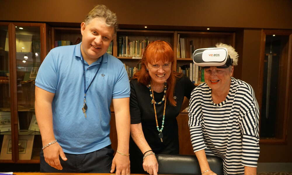 Library Officer - Programming Ricky Koopman (left), Library Manager Georgina Davison and Louise Wheller view the old and the new, with Virtual Reality technology that scans old photographs of local buildings and overlays them with an image from the current day.