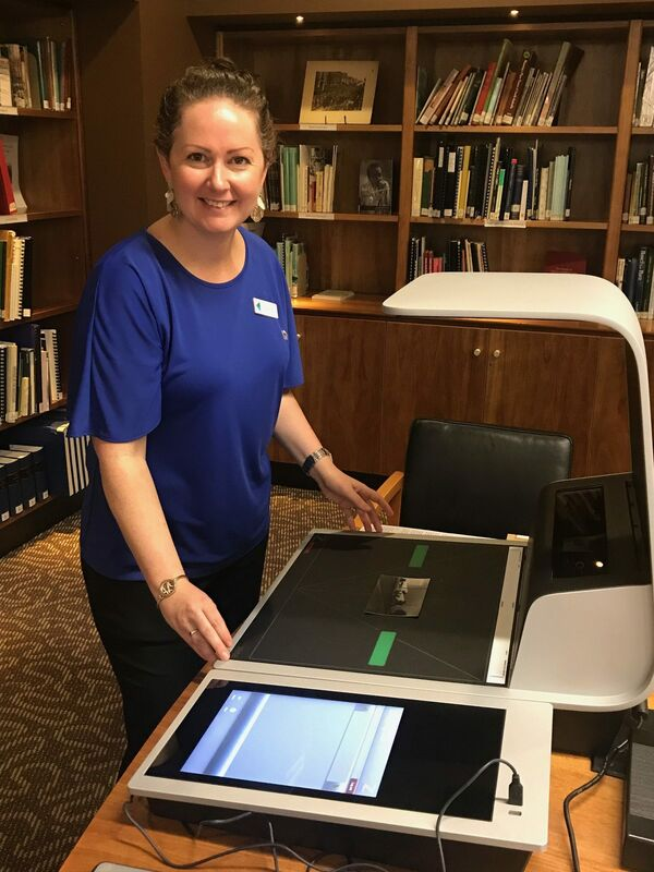 Local History Officer Danni Reade with the new Zeta Digital Scanner sponsored by OneFortyOne.