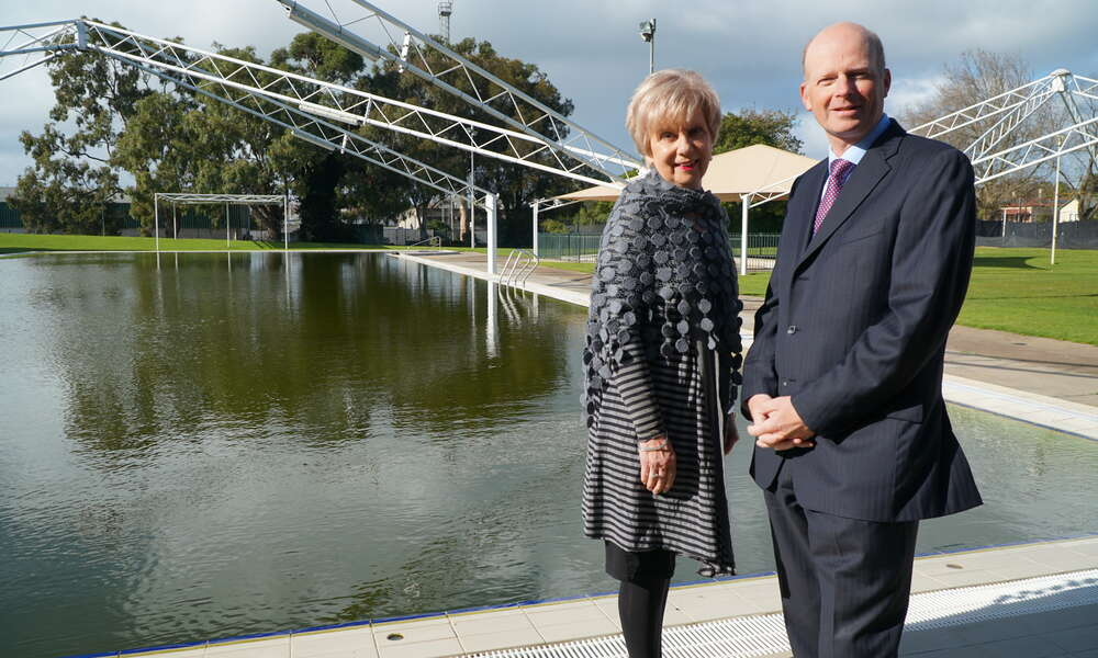 City of Mount Gambier Mayor Lynette Martin and CEO Andrew Meddle stand next to the 50 metre pool on site at the Aquatic Centre (currently closed due to the winter season). The pool will be refurbished to meet contemporary standards and provide an additional 15 years of use.