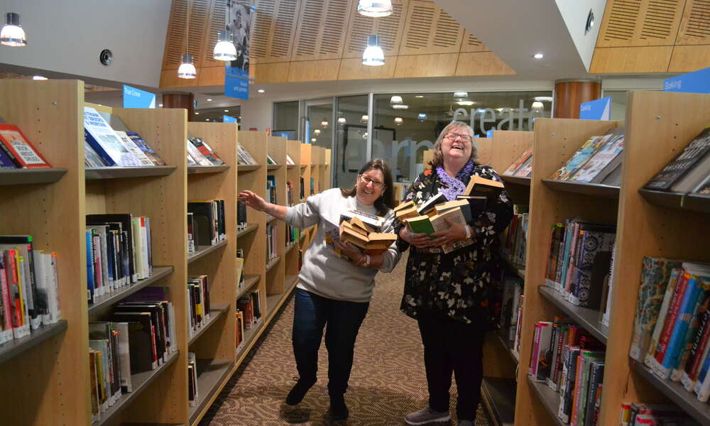 Library regulars embracing the chance to grab a bargain at the Big Book Sale.