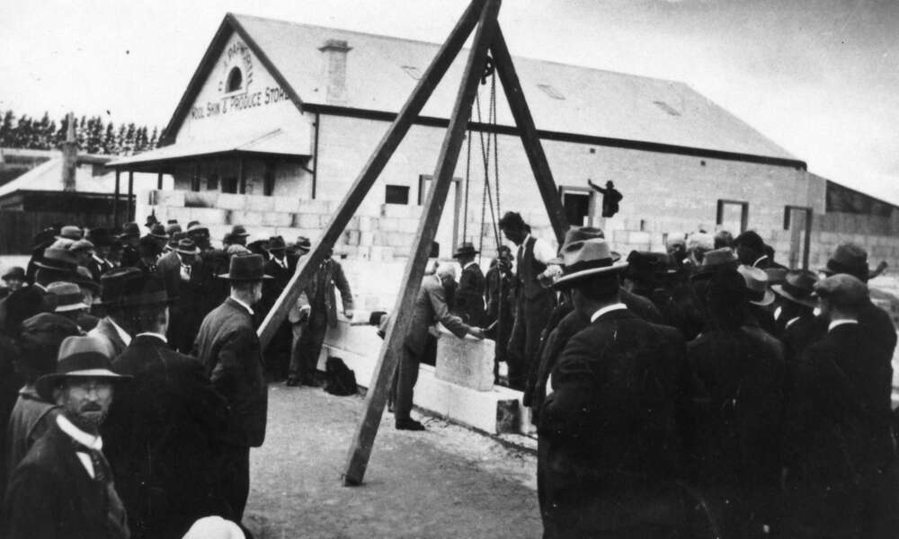 A digitised original photograph of the foundation stone being lowered into place by Mayor Spehr in 1924. - Les Hill Historical Collection, Mount Gambier Library.