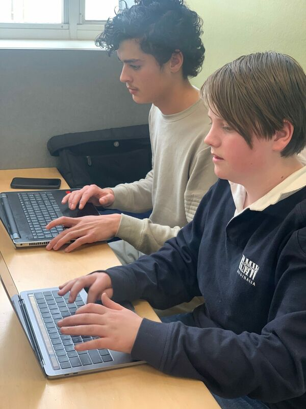 Seb McCarthy and George Comley (Team SG) busy hacking datasets around disabled parking.