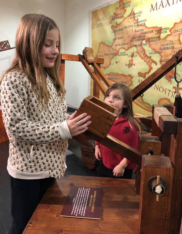 Stella and Astrid check out the Ancient Rome: The Empire that Shaped the World exhibition in readiness for the School Holiday Program at the Mount Gambier Library and The Riddoch & Main Corner Complex.