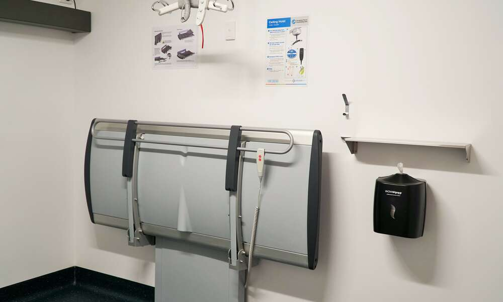 The Changing Places facility includes a range of features not available in standard accessible toilets such as a height adjustable adult sized change table, a tracking hoist system, non-slip flooring and space to accommodate a person using a wheelchair and up to two carers.