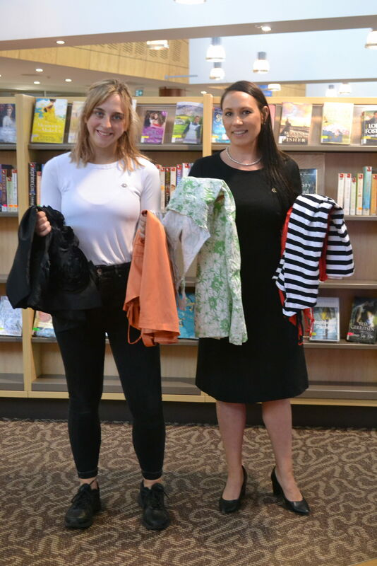 Library Trainee Events and Promotions Matilda Thompson and Team Leader Library Programs Kristi Leamey prepare items for the Library Clothes Swap as part of National Recycling Week.