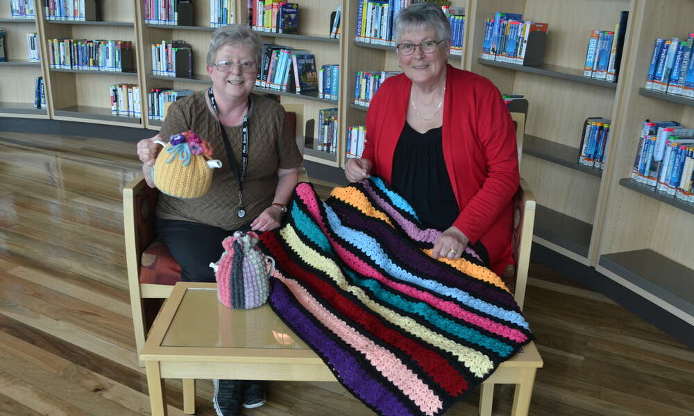 Mount Gambier Library Crochet Club volunteer coodinator Val Milner and member Rhonda Robinson have been busy getting ready for this weekend's exhibition.