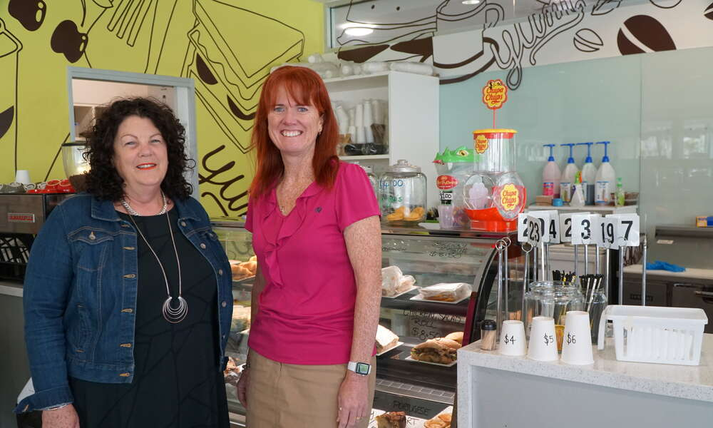 Mount Gambier Library Manager Georgina Davison (right) welcomes Limestone Coast Pantry Director Lyn McLachlan and the team to the Bookmark Cafe.