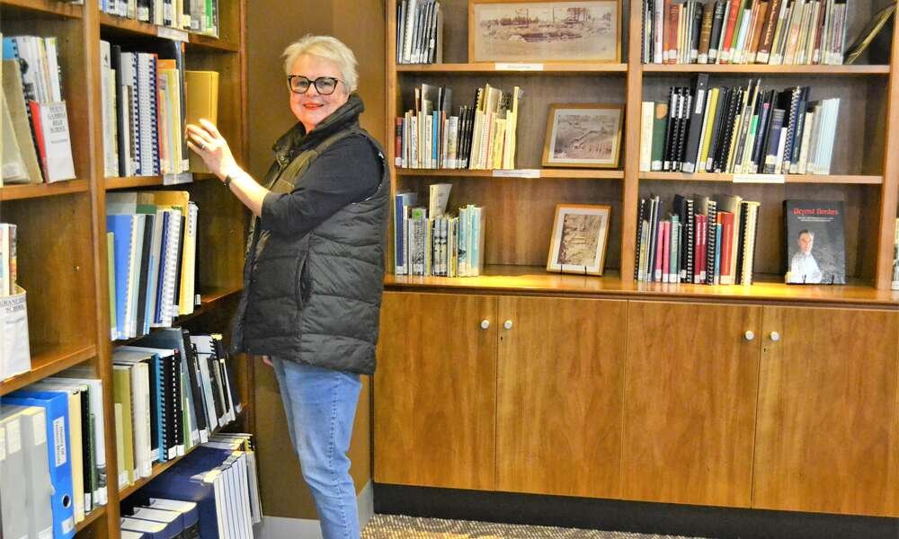 Mount Gambier Library Volunteer Louise Wheeler is pleased to back on deck lending a hand in the Les Hill Local History Room that has recently re-opened to the public.