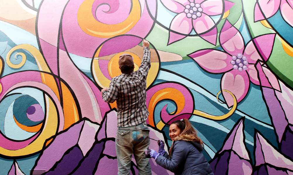 Wonder wall: visual artists Justin and Aileen Clarke have collaborated with Tenison Woods College students to transform a blank wall in a CBD thoroughfare into the city's newest public art project. Photo credit: Kate Hill