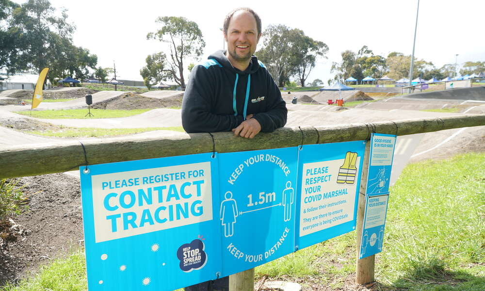 Blue Lake BMX President Stephen Jones with the event support package corflute signs placed around the track for the BMX SA 2020 Championships.