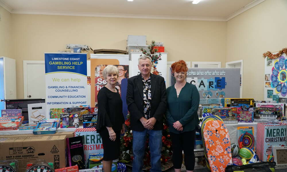 Mayor Lynette Martin and Lifeline CEO Leah Griffin (right) were blown away with the donation of toys to Lifeline's Christmas Cheer program from recent graduate of the Limestone Coast Regional Gambling Help Service Paul Sundstrom (centre).