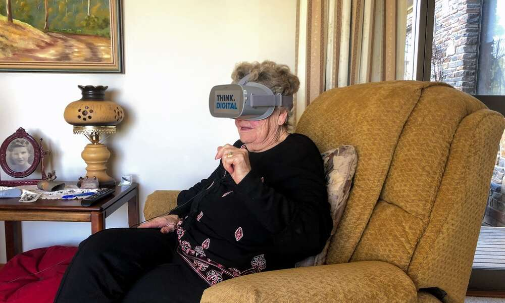 Mount Gambier resident Noela Hellyer experiencing local stories in VR thanks to the library's Immersive Storytelling project