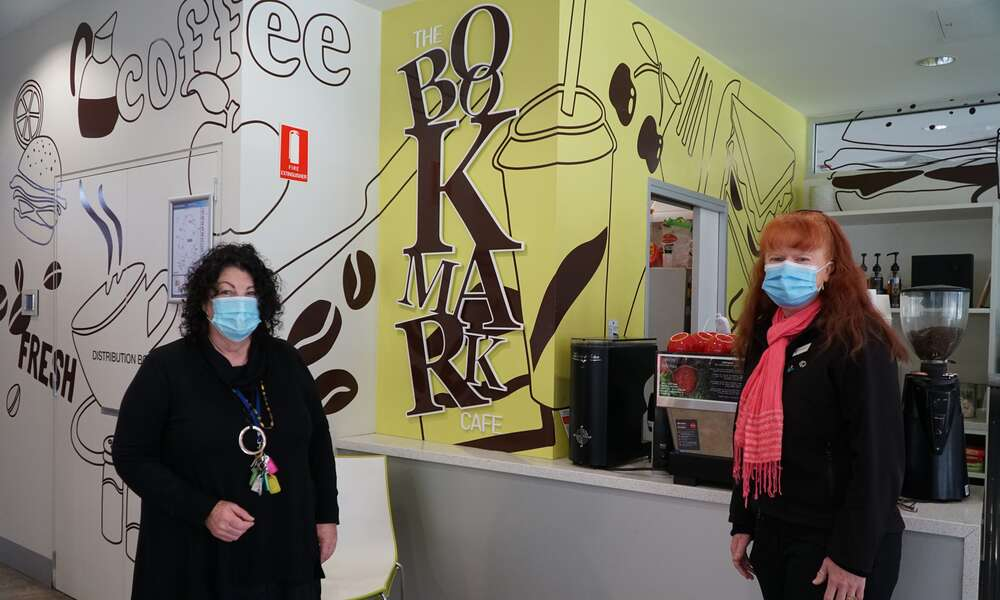 Limestone Coast Pantry owner Lyn McLachlan (left) and Acting City of Mount Gambier Community Wellbeing General Manager Georgina Davison at the Bookmark Café.