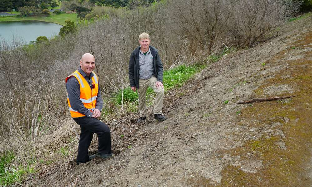 City of Mount Gambier Engineering Technical Officer Sinaway Georgiou (left) and Limestone Coast Landscape Board Officer Tony Bullock on the Crater Lakes slopes that will soon be cleared of pest weeds and revegetated with native plant species.