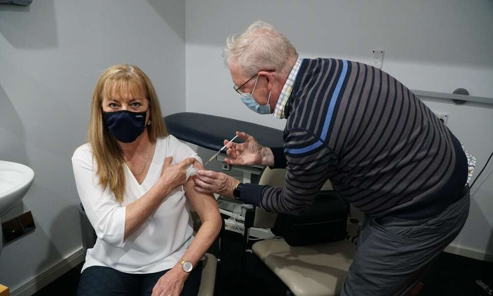 City of Mount Gambier Councillor Sonya Mezinec receives her second AstraZeneca vaccination administered by Dr Scott Milan at Hawkins Medical Clinic, Pinehall.